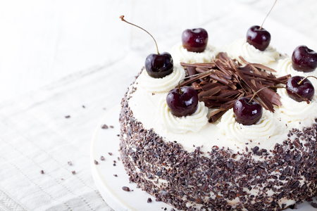 Photo pour Black forest cake, Schwarzwald pie, dark chocolate and cherry dessert on a white wooden background - image libre de droit