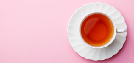 Foto de Cup of tea on pink background. Top view. Copy space. - Imagen libre de derechos