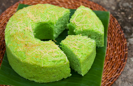 Photo for Pandan chiffon cake Traditional Indonesian desert Stone background Top view - Royalty Free Image