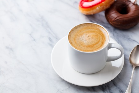 Foto für Cup coffee with donuts in marble table background. Copy space. - Lizenzfreies Bild
