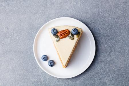 Foto de Vegan, raw carrot cake. Healthy food. Grey stone background. Top view - Imagen libre de derechos