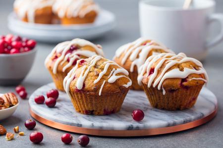 Foto de Muffins, cakes with cranberry and pecan nuts. Christmas decoration. Top view - Imagen libre de derechos
