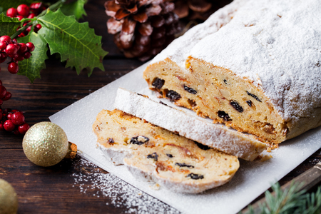 Photo pour Christmas stollen. Traditional German festive dessert. Wooden background. - image libre de droit
