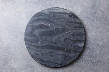 Photo pour Black marble texture board on grey background. Top view. Copy space. - image libre de droit