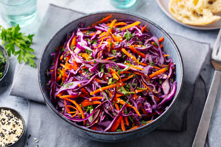 Photo for Red cabbage salad. Coleslaw in a bowl. Grey background. Close up. - Royalty Free Image