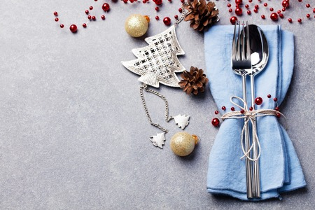 Foto de Christmas and New Year holiday table setting. Celebration place setting for dinner decorations. - Imagen libre de derechos