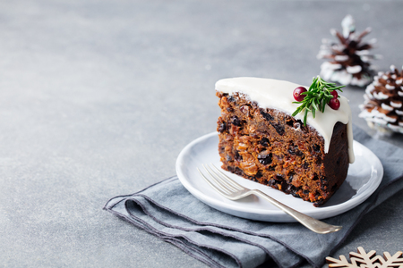 Photo pour Christmas fruit cake, pudding on white plate. Copy space. - image libre de droit