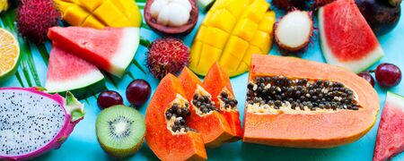 Photo for Assortment of tropical exotic fruits. Blue background. Top view. - Royalty Free Image