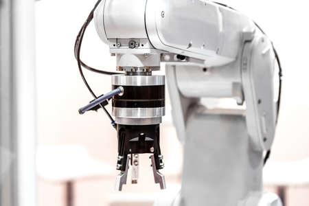 Foto de Industrial robot arm - Imagen libre de derechos