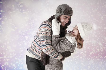 Happy funny couple covering snow background. Have a warm. Fool around.