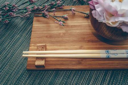 Foto de Oriental style tableware with flower decor and space for text - Imagen libre de derechos