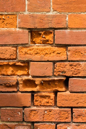 Foto de Frost damaged red bricks in a wall - Imagen libre de derechos
