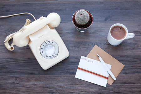 Foto de Old fashioned telephone with a mug of drinking chocolate and letter writing equipment - Imagen libre de derechos