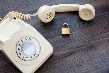Foto de Classic telephone and hand held receiver together with a locked padlock - Imagen libre de derechos