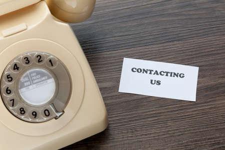 Foto de Retro telephone with note - Contacting Us - Imagen libre de derechos