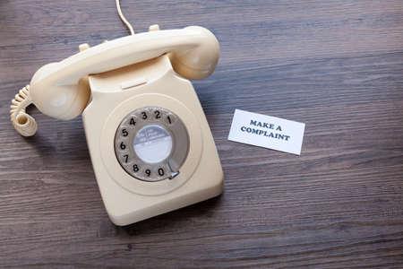 Foto de Retro telephone with note - Make a Complaint - Imagen libre de derechos