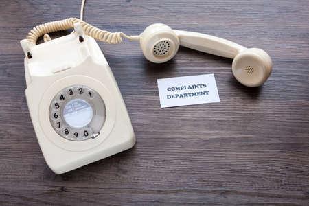 Foto de Retro telephone with note - Complaints Department - Imagen libre de derechos