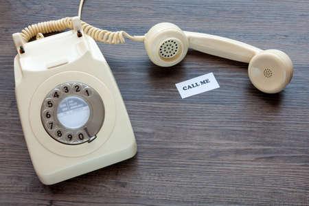Foto de Retro telephone with note - Call Me - Imagen libre de derechos