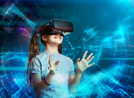 Photo pour Young girl using virtual reality glasses. Future technology concept. - image libre de droit