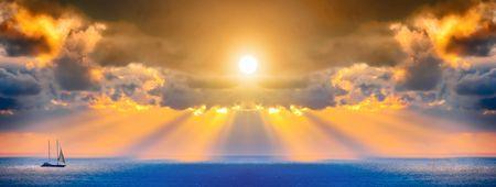 Photo pour Through clouds on the sea light flows  - image libre de droit
