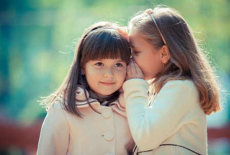 Foto de Happy little girlfriends in park - Imagen libre de derechos