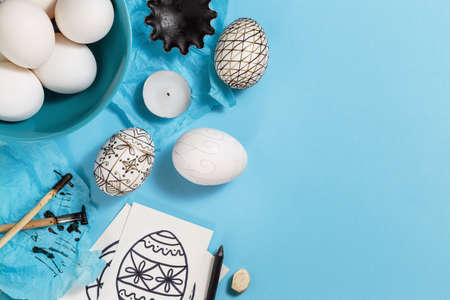 Foto für Preparation for Easter holiday. Tools for decorating Paschal eggs, Pysankas, with wax-resist dyeing technique, traditional for Eastern European countries. Top view, place for text - Lizenzfreies Bild