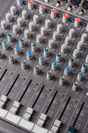Photo for Audio mixer with sliders and channels in closeup macro view. - Royalty Free Image