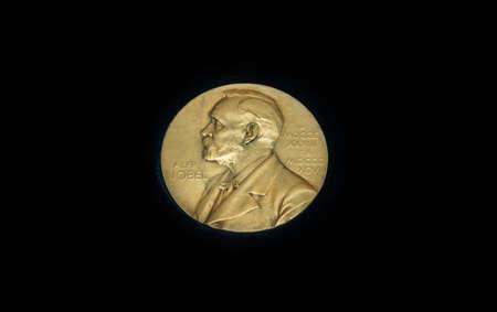 Foto de The medal is awarded annually to the prestigious international Nobel prize. Gold medal on black background - Imagen libre de derechos