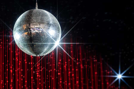 Photo for Disco ball with stars in nightclub with striped red and black walls lit by spotlight - Royalty Free Image