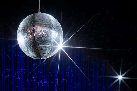 Foto de Disco ball with stars in nightclub with striped blue and black walls lit by spotlight, party and nightlife entertainment industry - Imagen libre de derechos