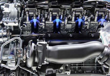 Photo pour Powerful engine with metal, chrome, steel, plastic parts and blue lights of automobile race motor - image libre de droit