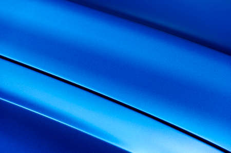 Photo for Surface of blue sport sedan car metal hood, part of vehicle bodywork, steel gradient line pattern, selective focus - Royalty Free Image