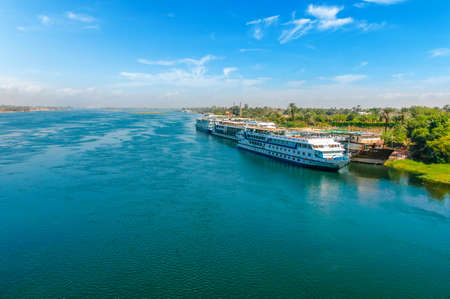 Foto per Cruise ship on the Nile river. Cairo. Giza. Egypt. Travel background. Vacation holidays background wallpaper - Immagine Royalty Free
