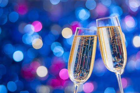 Photo for Two glasses of champagne with lights in the background. very shallow depth of field. Selective focus. - Royalty Free Image