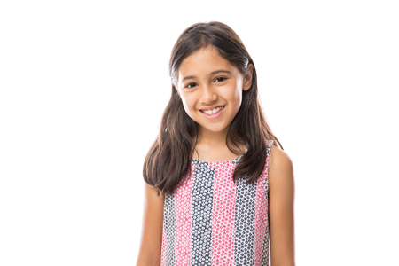Foto de Portrait of young beautiful little girl with t-shirt smiling to camera over white background - Imagen libre de derechos