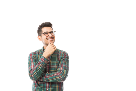 Foto de Thoughtful male hipster looking at copyspace on white background - Imagen libre de derechos