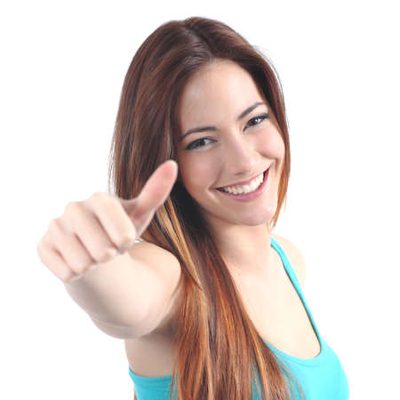 Close up of a beautiful teen with thumb up gesture on a white isolated background