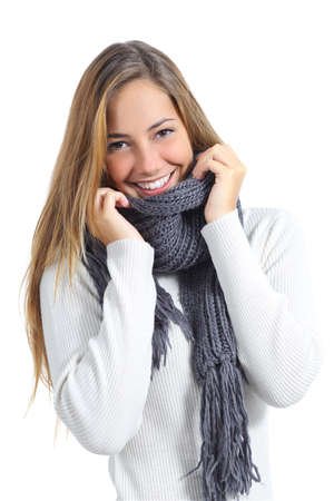 Photo pour Happy beautiful woman keeping warm in a sweater in a cold winter isolated on a white background               - image libre de droit