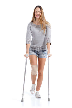 Photo pour Front view of a woman walking with crutches isolated on a white background               - image libre de droit
