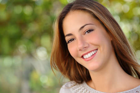 Foto per Beautiful white woman smile dental care concept with a green background - Immagine Royalty Free