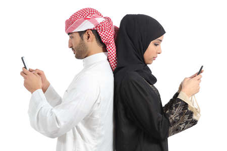Photo for Arab couple addicted to smart phone isolated on a white background              - Royalty Free Image