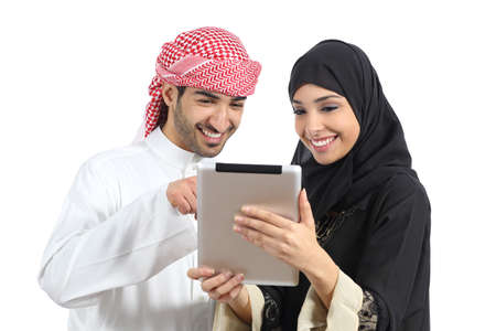 Photo for Arab saudi happy couple browsing a tablet reader isolated on a white background             - Royalty Free Image