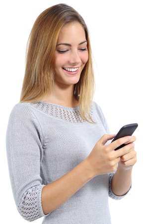 Foto de Beauty woman using and reading a smart phone isolated on a white background - Imagen libre de derechos