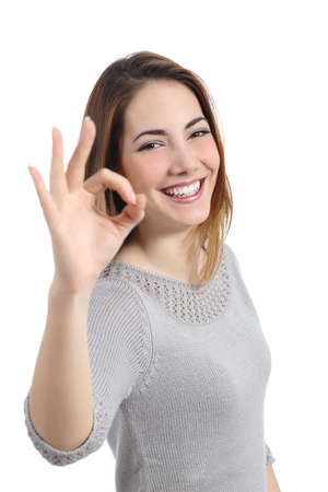 Happy woman gesturing ok isolated on a white background