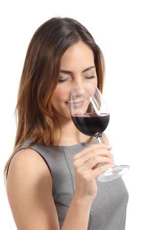 Foto de Beautiful sommelier woman tasting wine isolated on a white background            - Imagen libre de derechos