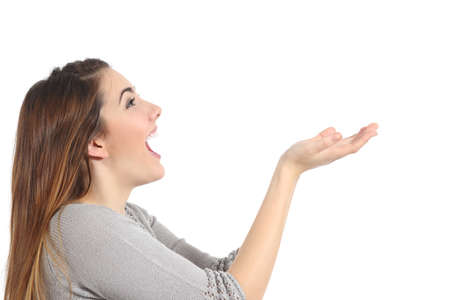 Profile of a woman holding something blank surprised isolated on a white background