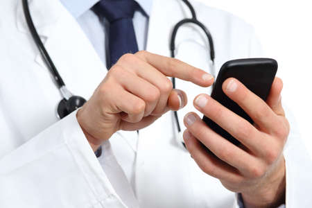 Foto de Doctor hands texting on a smart phone isolated on a white background - Imagen libre de derechos