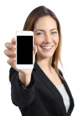 Foto de Business woman smiling showing a blank smart phone screen isolated on a white  - Imagen libre de derechos