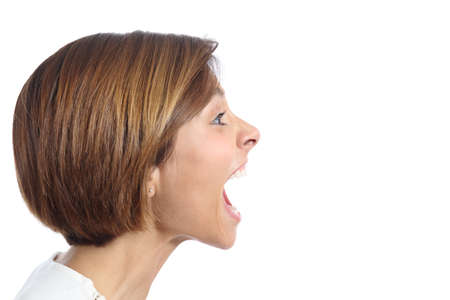 Photo for Profile of an angry young woman shouting isolated on a white background - Royalty Free Image
