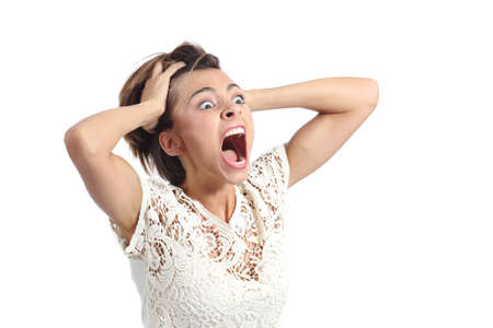 Foto de Scared crazy woman crying with hands on head isolated on a white background - Imagen libre de derechos